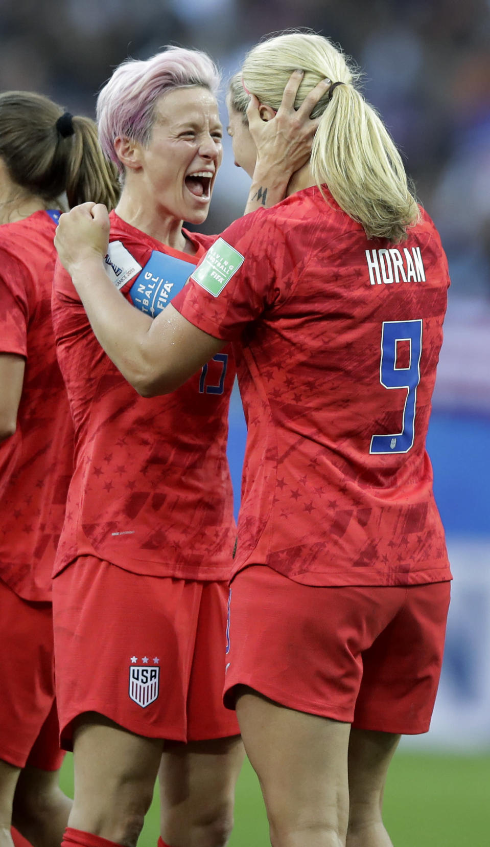 United States' scorer Lindsey Horan, right, and her teammate Megan Rapinoe, left, celebrate their side's 3rd goal during the Women's World Cup Group F soccer match between United States and Thailand at the Stade Auguste-Delaune in Reims, France, Tuesday, June 11, 2019. (AP Photo/Alessandra Tarantino)