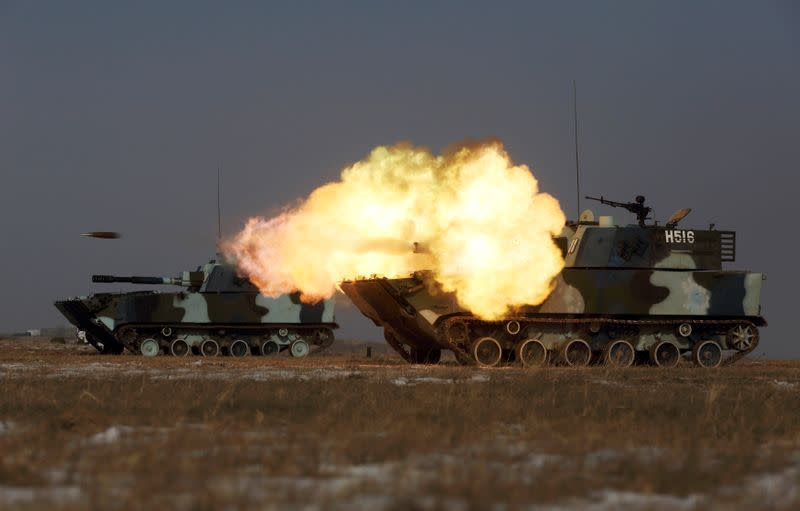 FILE PHOTO: Tank of the People's Liberation Army (PLA) Marine Corps fires during military drill at a military base in Taonan