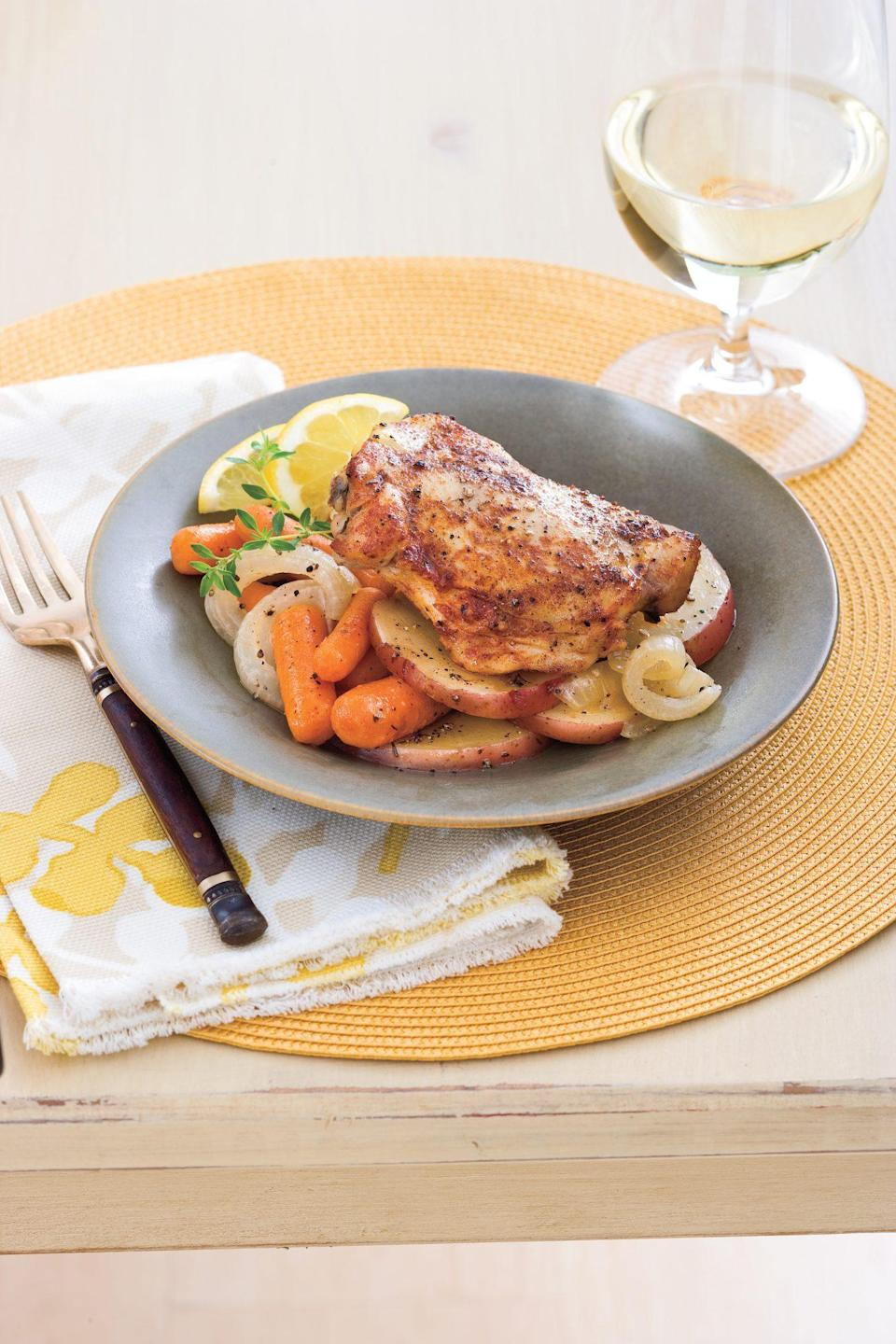 """<p><strong>Recipe: <a href=""""https://www.southernliving.com/recipes/crockpot-chicken-thighs-carrots-potatoes"""" rel=""""nofollow noopener"""" target=""""_blank"""" data-ylk=""""slk:Chicken Thighs with Carrots and Potatoes"""" class=""""link rapid-noclick-resp"""">Chicken Thighs with Carrots and Potatoes</a></strong></p> <p>This recipe allows you to cook your main and sides all at one time—and is much more budget-friendly that taking the whole family out to a restaurant after church.</p>"""
