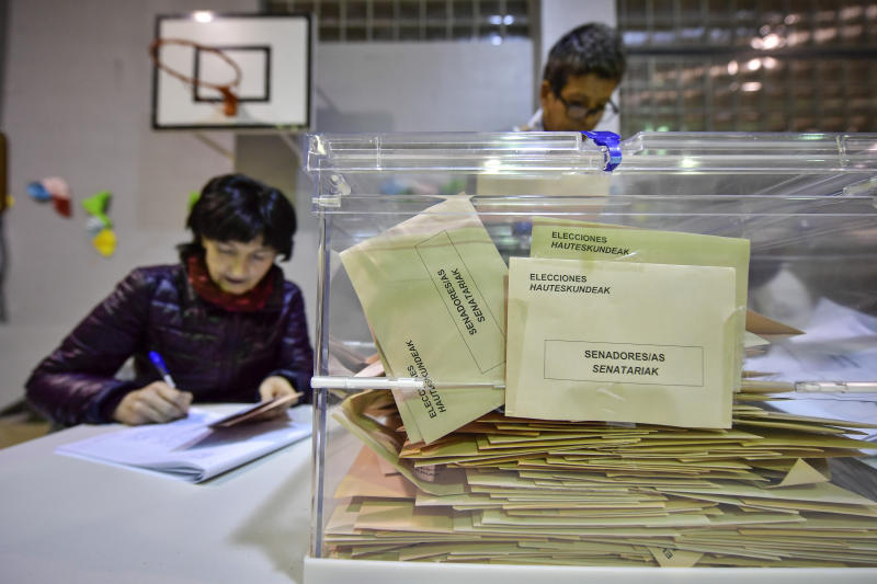 Election officials prepare to count the votes at a polling station for the general election, in Pamplona, northern Spain, Sunday, Nov. 10, 2019. As Spaniards voted Sunday in the country's fourth election in as many years, a leading leftist party pledged to help the incumbent Socialists in hopes of staving off a possible right-wing coalition government that could include a far-right party. (AP Photo/Alvaro Barrientos)