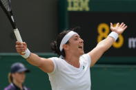 Tunisia's Ons Jabeur celebrates celebrates after defeating Poland's Iga Swiatek during the women's singles fourth round match on day seven of the Wimbledon Tennis Championships in London, Monday, July 5, 2021. (AP Photo/Alberto Pezzali)