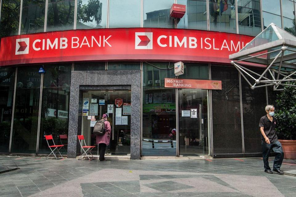 CIMB said that both the six-month moratorium and six-month halved payment options for a property loan or personal loan would not result in the loan tenure being extended, saying that borrowers may instead have to pay a lump sum or higher amount at the end of the loan's tenure to settle the entire loan. — Picture by Firdaus Latif