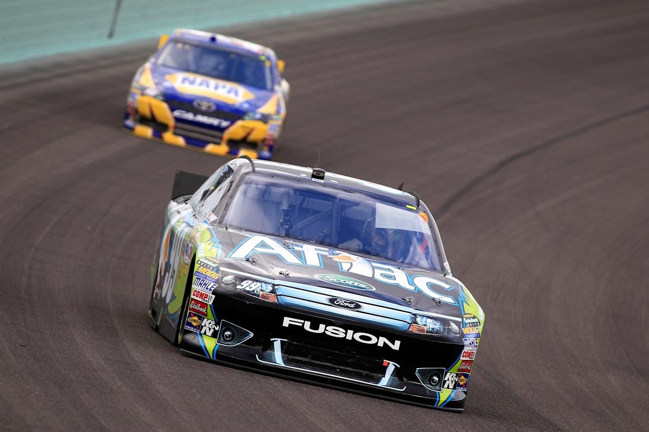 HOMESTEAD, FL - NOVEMBER 20:  Carl Edwards, driver of the #99 Aflac Ford, drives ahead of Martin Truex Jr., driver of the #56 NAPA Auto Parts Toyota, during the NASCAR Sprint Cup Series Ford 400 at Homestead-Miami Speedway on November 20, 2011 in Homestead, Florida.  (Photo by Chris Trotman/Getty Images for NASCAR)