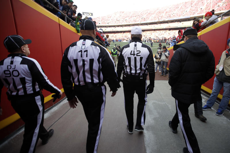 NFL officials walk in the tunnel before an NFL wild-card playoff football game between the Kansas City Chiefs and the Tennessee Titans. (AP)