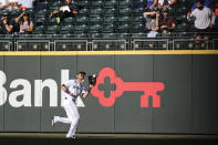 Seattle Mariners right fielder Mitch Haniger makes the catch for the out on Cleveland Indians' Cesar Hernandez during the third inning of a baseball game Saturday, May 15, 2021, in Seattle. (AP Photo/Jason Redmond)