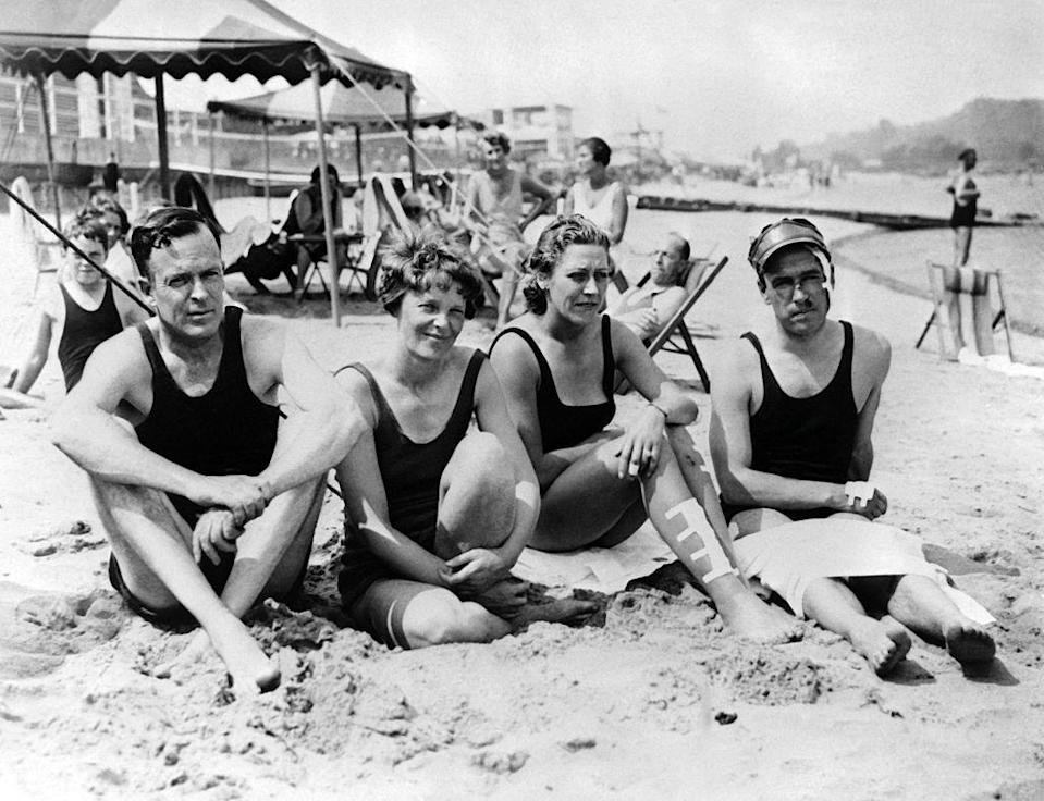 <p>Amelia Earhart with her husband, George P. Putnam and British aviators Jim and Amy Mollison on the beach at Atlantic City, New Jersey.<br></p><p>Other celebrity visitors this year: boxers Max Baer and Jack Dempsey.</p>