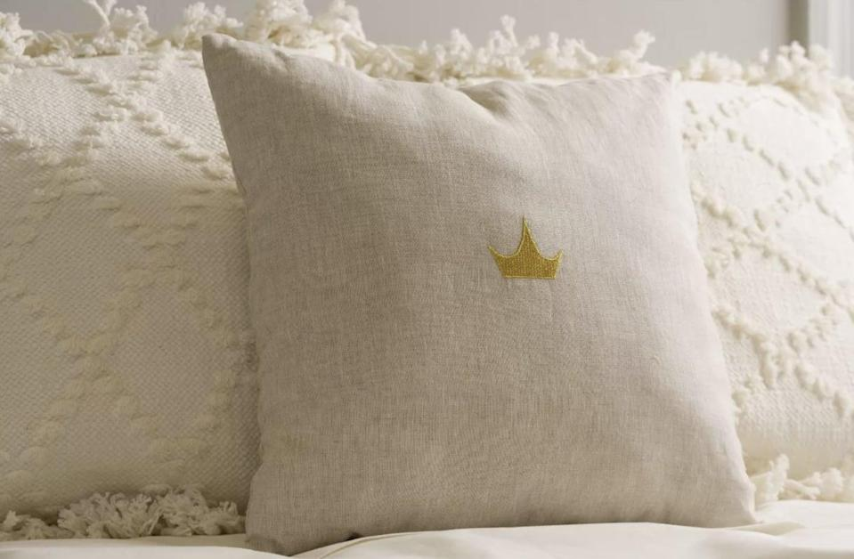 <p>Show your love of all things Disney Princess with this simple, crisp and embroidered <span>Disney Princess X POPSUGAR Crown Decor Pillow</span> ($20).</p>