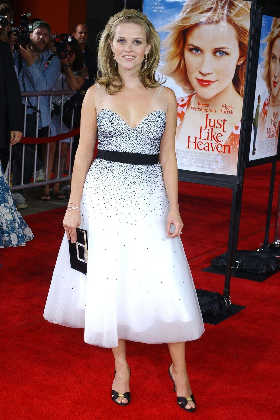 <p>Standing pretty in a tea length Monique Lhuillier sequin frock at the premiere of her movie <em>Just Like Heaven. </em></p>