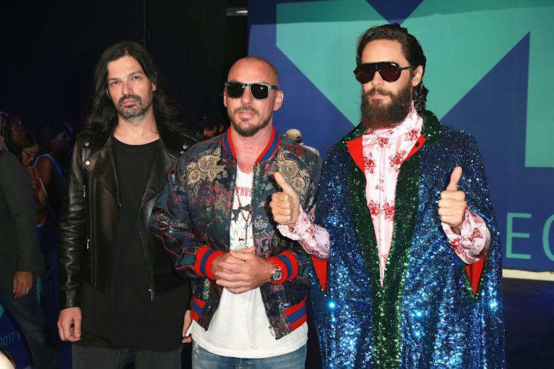 Tomo Milicevic, Shannon Leto and Jared Leto of music group Thirty Seconds to Mars attend the 2017 MTV Video Music Awards on Sunday night. (Rich Fury via Getty Images)