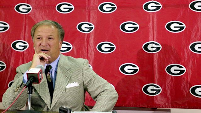 FILE - In this Aug. 7, 2000 file photo, Georgia football coach Jim Donnan speaks during the team's preseason media day in Athens, Ga. A prosecutor said former University of Georgia football coach Donnan lured his friends into a fraudulent investment scheme because he was blinded by the enormous amount of money he could make. Prosecutor Pete Peterman made that assertion Wednesday in his closing argument in Donnan's trial on charges including wire fraud, mail fraud and money laundering. (AP Photo/Athens Daily News, Dot Paul, File)