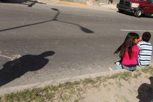This file photo shows children sitting on the street in Juarez, Mexico, in 2010