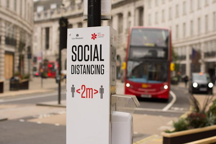 LONDON, UNITED KINGDOM - 2021/02/22: A social distance sign in Regent Street amid covid-19 pandemic. (Photo by Pietro Recchia/SOPA Images/LightRocket via Getty Images)