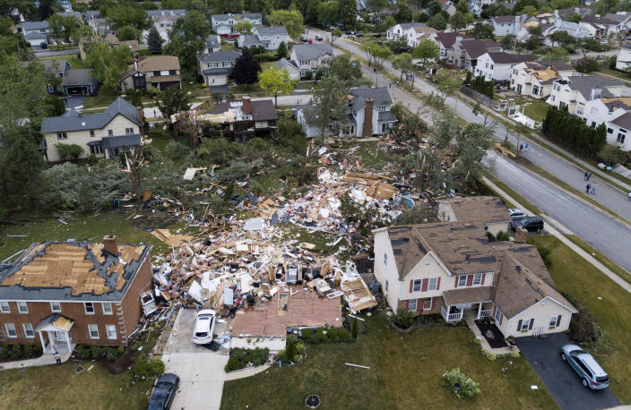 A home on the 1800 block of Princeton Circle is leveled after an overnight tornado swept through the area in Naperville, Ill., Monday, June 21, 2021.(Paul Valade/Daily Herald via AP)