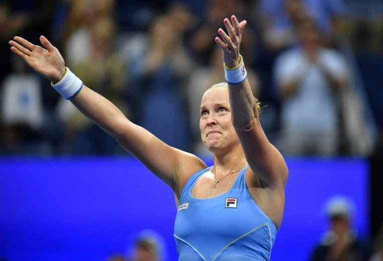 """""""I didn't want to leave,"""" US player Shelby Rogers says after beating Australia's Ashleigh Barty (AFP/Ed JONES)"""