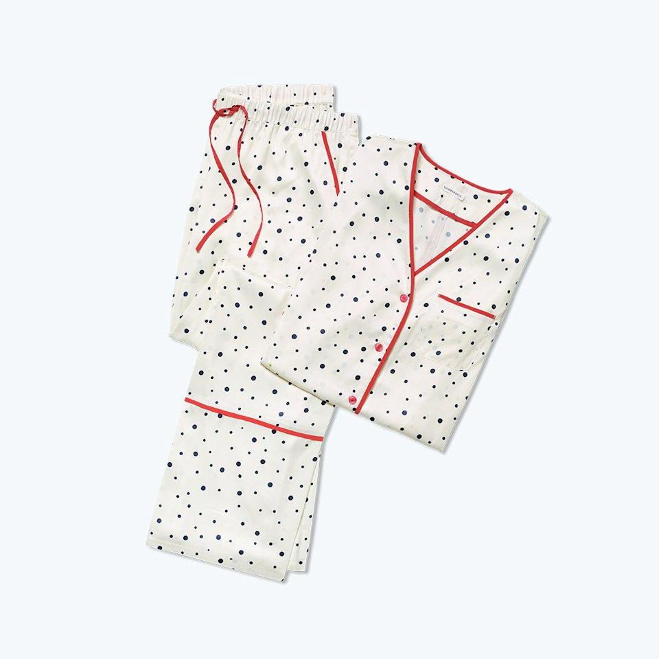 """We're almost certain <a href=""""https://www.glamour.com/gallery/best-pajamas-loungewear-shopping?mbid=synd_yahoo_rss"""" rel=""""nofollow noopener"""" target=""""_blank"""" data-ylk=""""slk:silk pajama sets"""" class=""""link rapid-noclick-resp"""">silk pajama sets</a> are going to be their kind of dressing up for the holidays this year. $95, Summersalt. <a href=""""https://www.summersalt.com/products/the-cloud-9-silky-pajama-set-celestial-dot-in-white-sand"""" rel=""""nofollow noopener"""" target=""""_blank"""" data-ylk=""""slk:Get it now!"""" class=""""link rapid-noclick-resp"""">Get it now!</a>"""