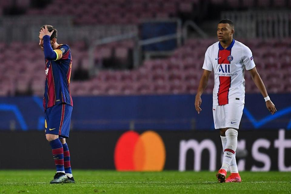 Lionel Messi shows his dejection next to Kylian Mbappe (Getty)