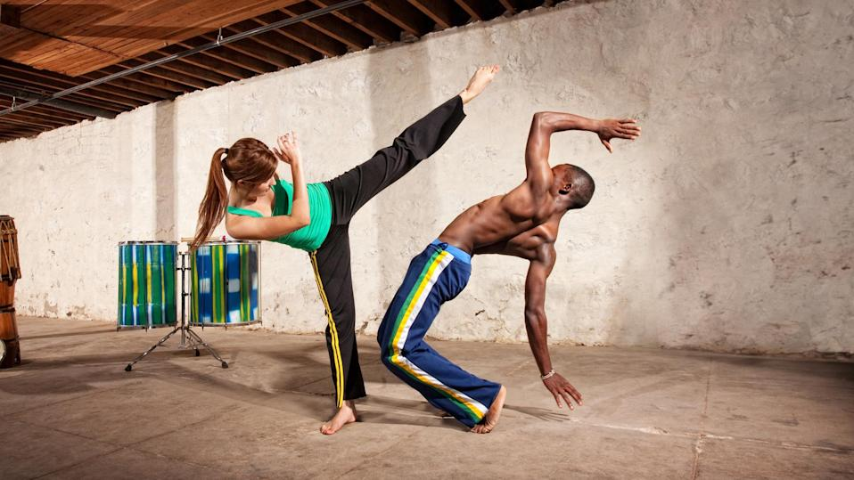 Man and woman doing capoeira