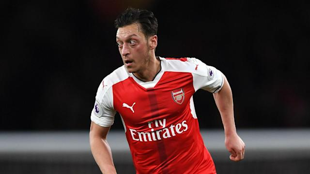 Midfielder Mesut Ozil eased the pressure on himself and Arsene Wenger by leading Arsenal to an eventually comfortable win over West Ham.