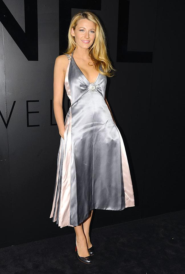 """In her first public appearance since her surprise wedding to Ryan Reynolds last month, """"Gossip Girl"""" actress Blake Lively stunned at the event in a silver-and-pink Chanel gown paired with Christian Louboutin heels. And if she would just take her hands out of her pockets, we could get a glimpse of her new diamond ring! (10/9/2012)"""