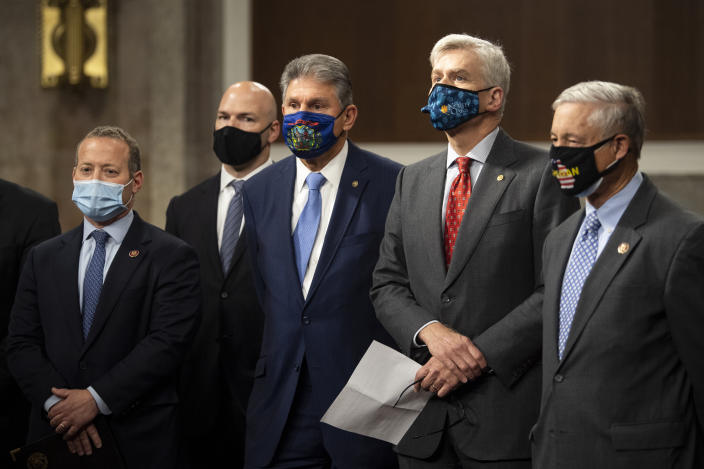 UNITED STATES - DECEMBER 1: Rep. Josh Gottheimer, D-N.J., left, Rep. Anthony Gonzalez, R-Ohio, Sen. Joe Manchin, D-W. Va., Sen. Bill Cassidy, R-La., and Rep. Fred Upton, R-Mich., attend a news conference with a group of bipartisan lawmakers to unveil a COVID-19 emergency relief framework in the Dirksen Senate Office Building in Washington on Tuesday, Dec. 1, 2020. (Photo by Caroline Brehman/CQ-Roll Call, Inc via Getty Images)