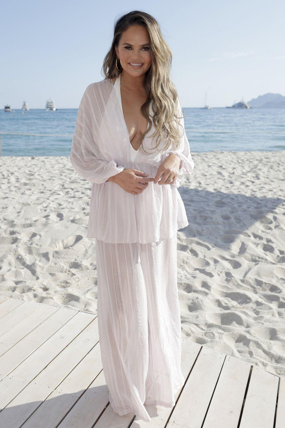 <p>Who: Chrissy Teigen </p><p>When: June 18, 2019</p><p>Wearing: Adriana Degreas</p><p>Why: This just might be the perfect beach look. Chrissy Teigen attended #TwitterBeach in Cannes, France in a monochromatic look we plan to copy on our next vacation. </p>