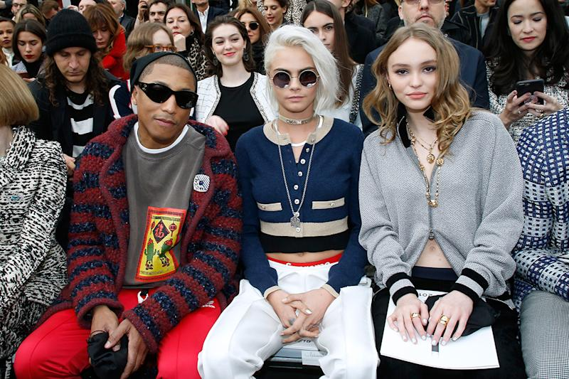 Pharrell Williams, Cara Delevingne and Lily-Rose Depp in the front row at the Chanel show as part of the Paris Fashion Week Womenswear Fall/Winter 2017/2018 on March 7, 2017 in Paris, France. (Photo: Getty Images)
