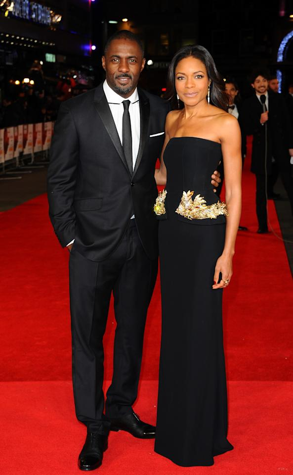 """LONDON, ENGLAND - DECEMBER 05: Actors Idris Elba and Naomie Harris attend the Royal film performance of """"Mandela: Long Walk to Freedom"""" on December 5, 2013 in London, United Kingdom. (Photo by Anthony Harvey/Getty Images)"""