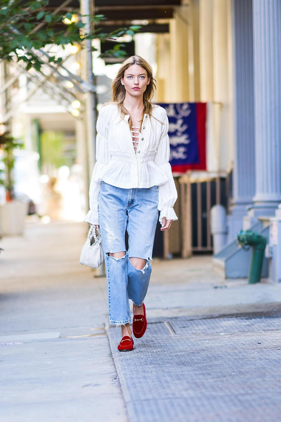 <p>Martha Hunt just expressed our summer mood in one outfit: Ripped jeans, a floaty white top and loafers. <em>[Photo: Getty]</em> </p>