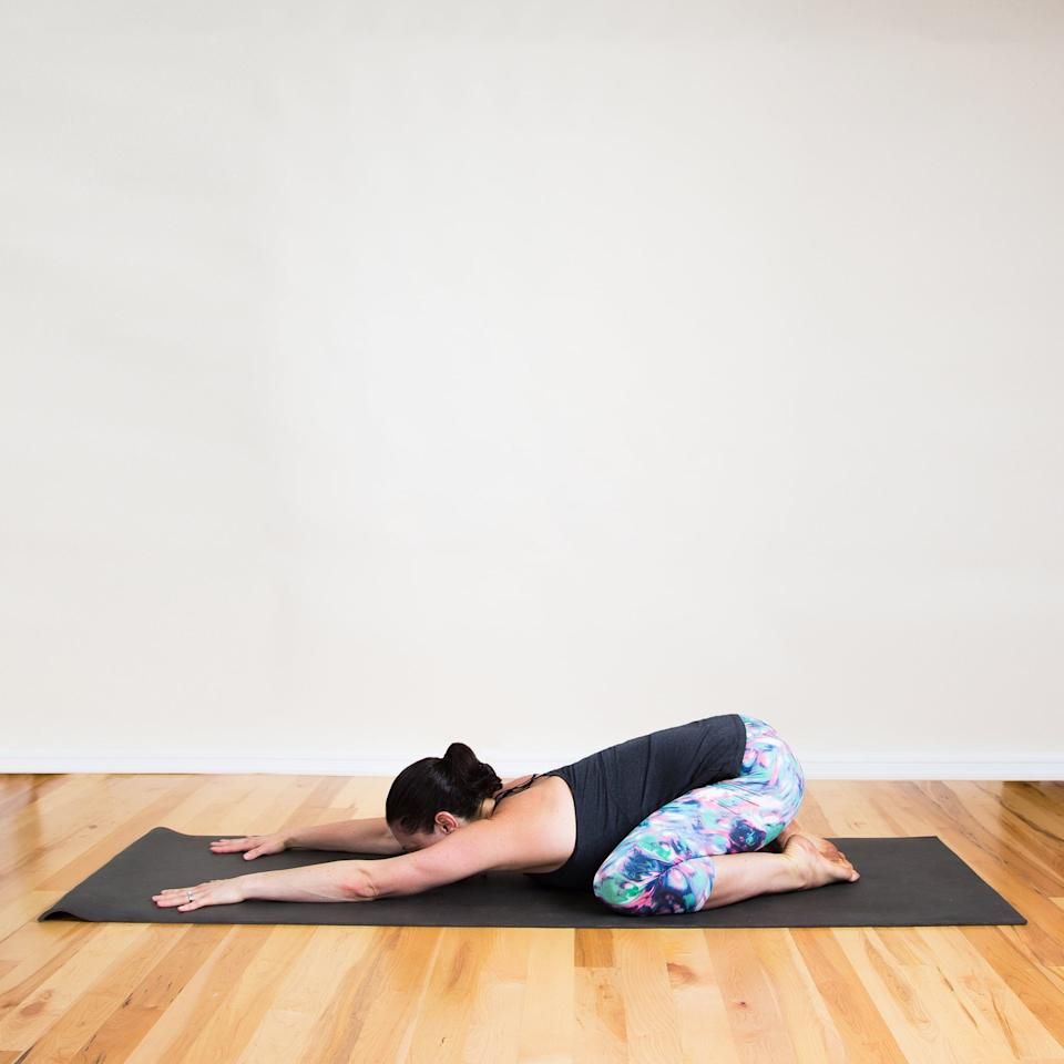 <p>This variation opens the hips more deeply.</p> <ul> <li>Separate your knees so they're wider than hips-width distance apart. </li> <li>Take a deep breath in and as you exhale, fold forward, extending your arms out in front of you.</li> <li>Enjoy this stretch for five breaths.</li> </ul>