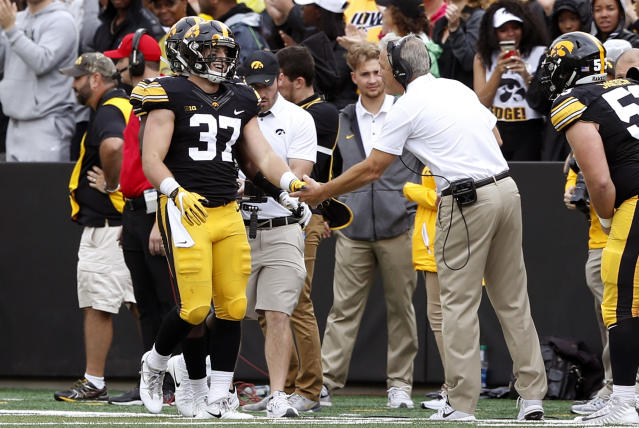 """Iowa defensive back <a class=""""link rapid-noclick-resp"""" href=""""/ncaaf/players/250855/"""" data-ylk=""""slk:Brandon Snyder"""">Brandon Snyder</a> (37) celebrates with head coach Kirk Ferentz, right, after returning an interception 89-yards for a touchdown during the second half of an NCAA college football game against Illinois, Saturday, Oct. 7, 2017, in Iowa City, Iowa. Iowa won 45-16. (AP Photo/Charlie Neibergall)"""
