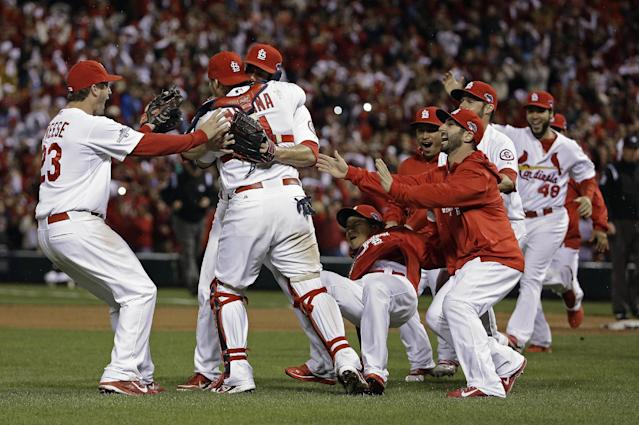 The St. Louis Cardinals celebrate after Game 6 of the National League baseball championship series against the Los Angeles Dodgers Friday, Oct. 18, 2013, in St. Louis. The Cardinals won 9-0 to win the series. (AP Photo/David J. Phillip)