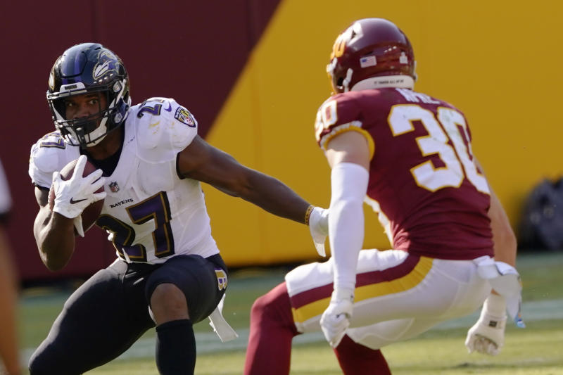 Baltimore Ravens running back J.K. Dobbins (27) runs against Washington Football Team free safety Troy Apke (30) during the second half of an NFL football game, Sunday, Oct. 4, 2020, in Landover, Md. (AP Photo/Susan Walsh)
