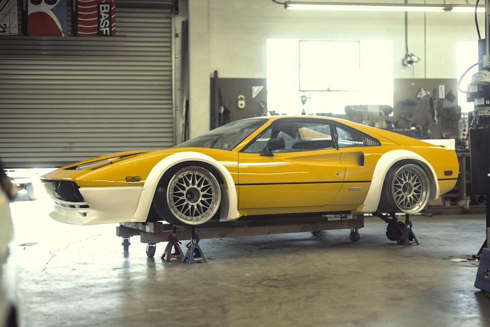 """<p>See the full story on this K-swapped Ferrari 308 <a href=""""https://www.roadandtrack.com/car-culture/a36330800/meet-the-batshit-turbocharged-widebody-honda-swapped-ferrari-of-our-dreams/"""" rel=""""nofollow noopener"""" target=""""_blank"""" data-ylk=""""slk:right here"""" class=""""link rapid-noclick-resp"""">right here</a>. </p>"""