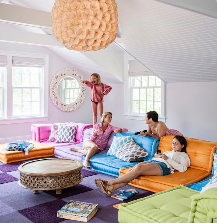 "<div class=""caption""> A colorful Roche Bobois sectional brings whimsy to the media room in a summer home in Bellport, New York. </div> <cite class=""credit"">Photo: © <em>Design Fix</em> by Robert and Cortney Novogratz, Rizzoli New York, 2020</cite>"