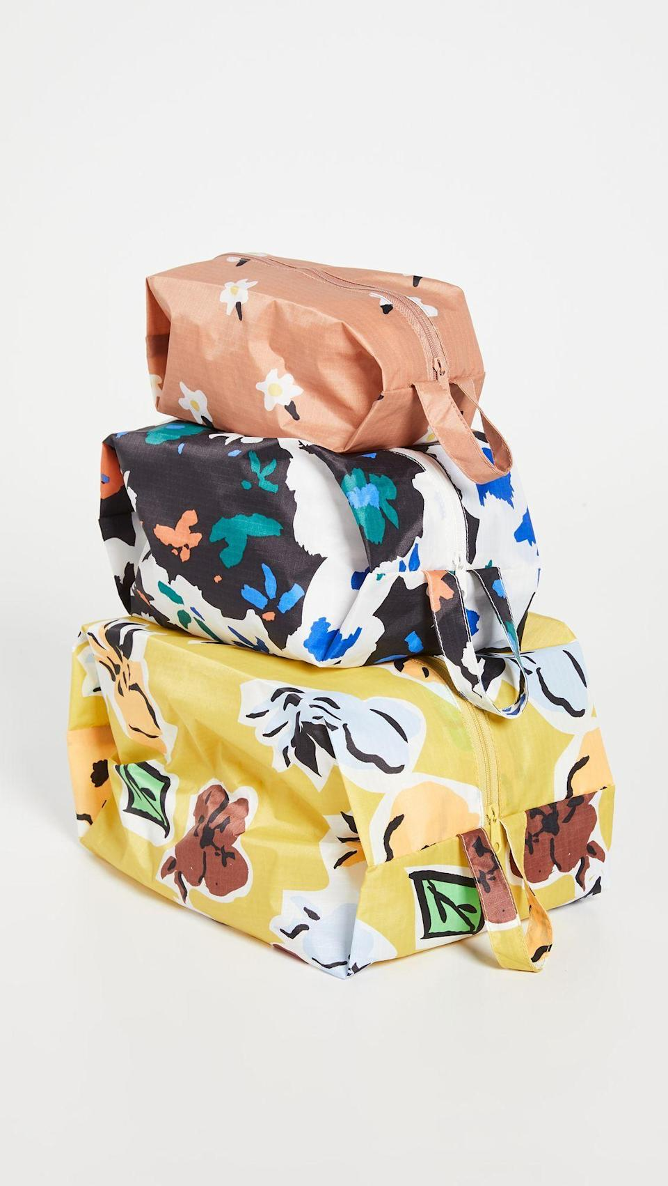 """<p><strong>Baggu</strong></p><p>shopbop.com</p><p><strong>$34.00</strong></p><p><a href=""""https://go.redirectingat.com?id=74968X1596630&url=https%3A%2F%2Fwww.shopbop.com%2Fzip-set-baggu%2Fvp%2Fv%3D1%2F1525889169.htm&sref=https%3A%2F%2Fwww.harpersbazaar.com%2Fbeauty%2Fmakeup%2Fg37004535%2Fbest-toiletry-bags%2F"""" rel=""""nofollow noopener"""" target=""""_blank"""" data-ylk=""""slk:Shop Now"""" class=""""link rapid-noclick-resp"""">Shop Now</a></p><p>The whole family is covered with this trio of adorably printed (and surprisingly durable) zip-up bags.</p>"""