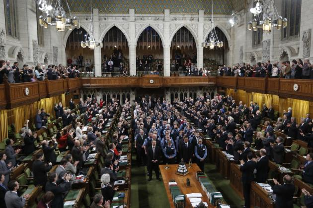 House of Commons security guards receive a standing ovation from Members of Parliament. REUTERS/Chris Wattie (CANADA - Tags: POLITICS)