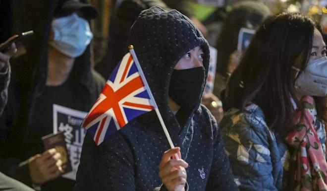 Activists take part in a rally outside the British consulate on Saturday evening. Photo: Edmond So