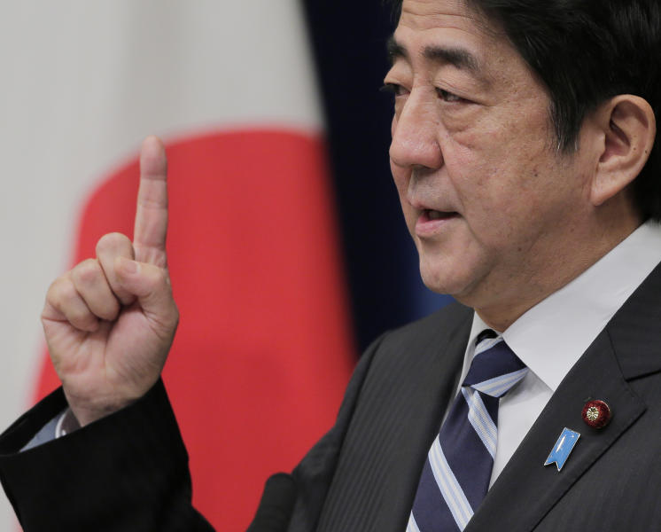 Japanese Prime Minister Shinzo Abe gestures during a news conference at his official residence in Tokyo, Friday, Jan. 11, 2013. The Japanese Cabinet approved a fresh stimulus spending of more than 20 trillion yen ($224 billion) on Friday, rushing to fulfill campaign pledges to break the world's third-biggest economy out of its deflationary slump. (AP Photo/Itsuo Inouye)