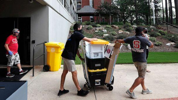 PHOTO: In this July 31, 2020, file photo, college students begin moving in for the fall semester at N.C. State University in Raleigh, N.C. (Gerry Broome/AP, FILE)