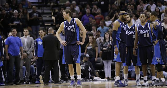 Dallas Mavericks' Dirk Nowitzki (41), of Germany, stands alone during a timeout as the team waits for play to resume during the second half of Game 5 of the opening-round NBA basketball playoff series against the San Antonio Spurs, Wednesday, April 30, 2014, in San Antonio. San Antonio won 109-103. (AP Photo/Eric Gay)