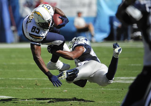 Dallas Cowboys free safety Barry Church, right, tackles San Diego Chargers tight end Antonio Gates during the first half of an NFL football game Sunday, Sept. 29, 2013, in San Diego. (AP Photo/Denis Poroy)