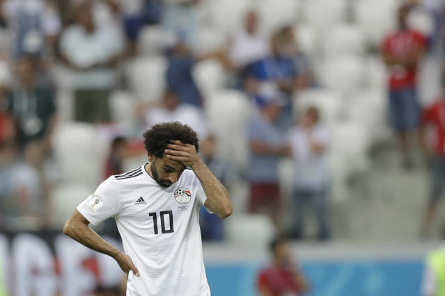 Egypt's Mohamed Salah reacts after Saudi Arabia's Salem Aldawsari scored his side' second goal during the group A match between Saudi Arabia and Egypt at the 2018 soccer World Cup at the Volgograd Arena in Volgograd, Russia, Monday, June 25, 2018. (AP Photo/Andrew Medichini)