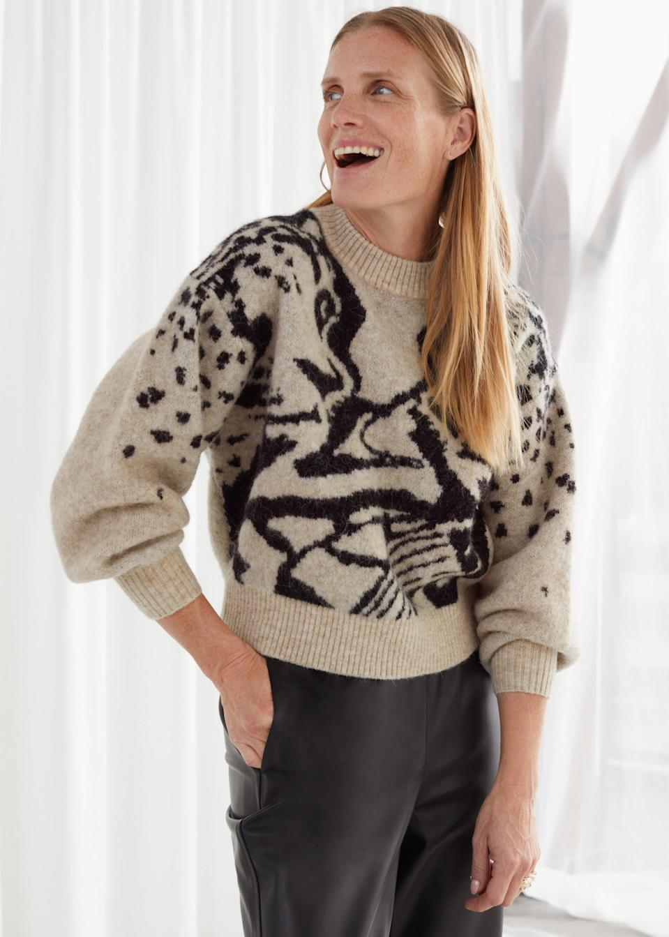 "<p>""The most critical factor to consider when it comes to sweater shopping is fit. I love loose-fitting sweaters with balloon or relaxed sleeves, and this cropped <span>& Other Stories Jacquard Knit Sweater</span> ($119) hits such a good balance between the sleeves and cuffs. The print is epic. I want to wear this with gold jewelry."" - RB</p>"