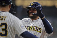 Milwaukee Brewers' Rowdy Tellez gestures to the dugout after hitting an RBI single during the fourth inning of the team's baseball game against the Chicago White Sox on Friday, July 23, 2021, in Milwaukee. (AP Photo/Aaron Gash)