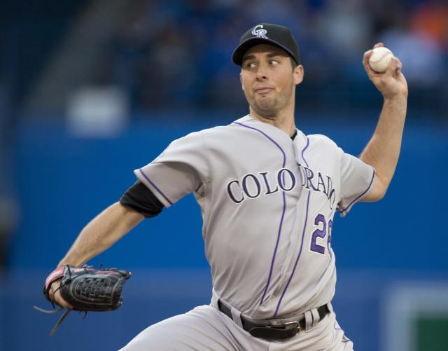 Colorado Rockies pitcher Jeff Francis throws against the Toronto Blue Jays during first inning of a baseball game in Toronto on Tuesday June 18, 2013. (AP Photo/The Canadian Press, Frank Gunn)