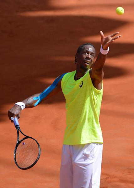 France's Gael Monfils serves the ball during the second round match against Argentina's Juan Monaco during the 2013 International German Open in Hamburg, Germany, Wednesday July 17, 2013. (AP Photo/dpa,Axel Heimken)