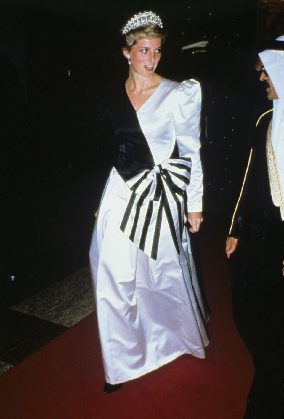 <p>During a royal tour of Saudi Arabia, Diana sported a powder blue and black dress by the Emmanuels to a dinner hosted by the Saudi Crown Prince. Diana completed the outfit with the Lover's Knot tiara. </p>