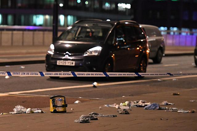 <p>Debris and abandoned cars remain on London at the scene of an apparent terror attack in central London on June 3, 2017.<br> Armed police fired shots after reports of stabbings and a van hitting pedestrians on London Bridge on Saturday in an incident reminiscent of a terror attack in March just days ahead of a general election. (Chris J Ratcliffe/AFP/Getty Images) </p>