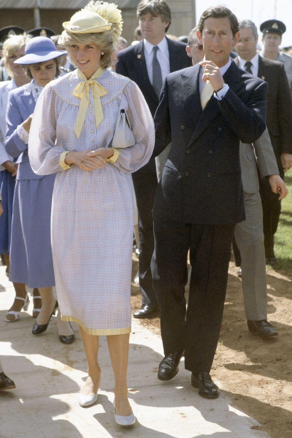 <p>In a blue-and-yellow dress and matching yellow hat while out in Canada with Prince Charles. </p>