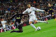 Real Madrid's Cristiano Ronaldo (R) fights for the ball with Tottenham Hotspur's Davinson Sanchez during their UEFA Champions League Group H first leg match, at the Santiago Bernabeu stadium in Madrid, on October 17, 2017 (AFP Photo/PIERRE-PHILIPPE MARCOU )
